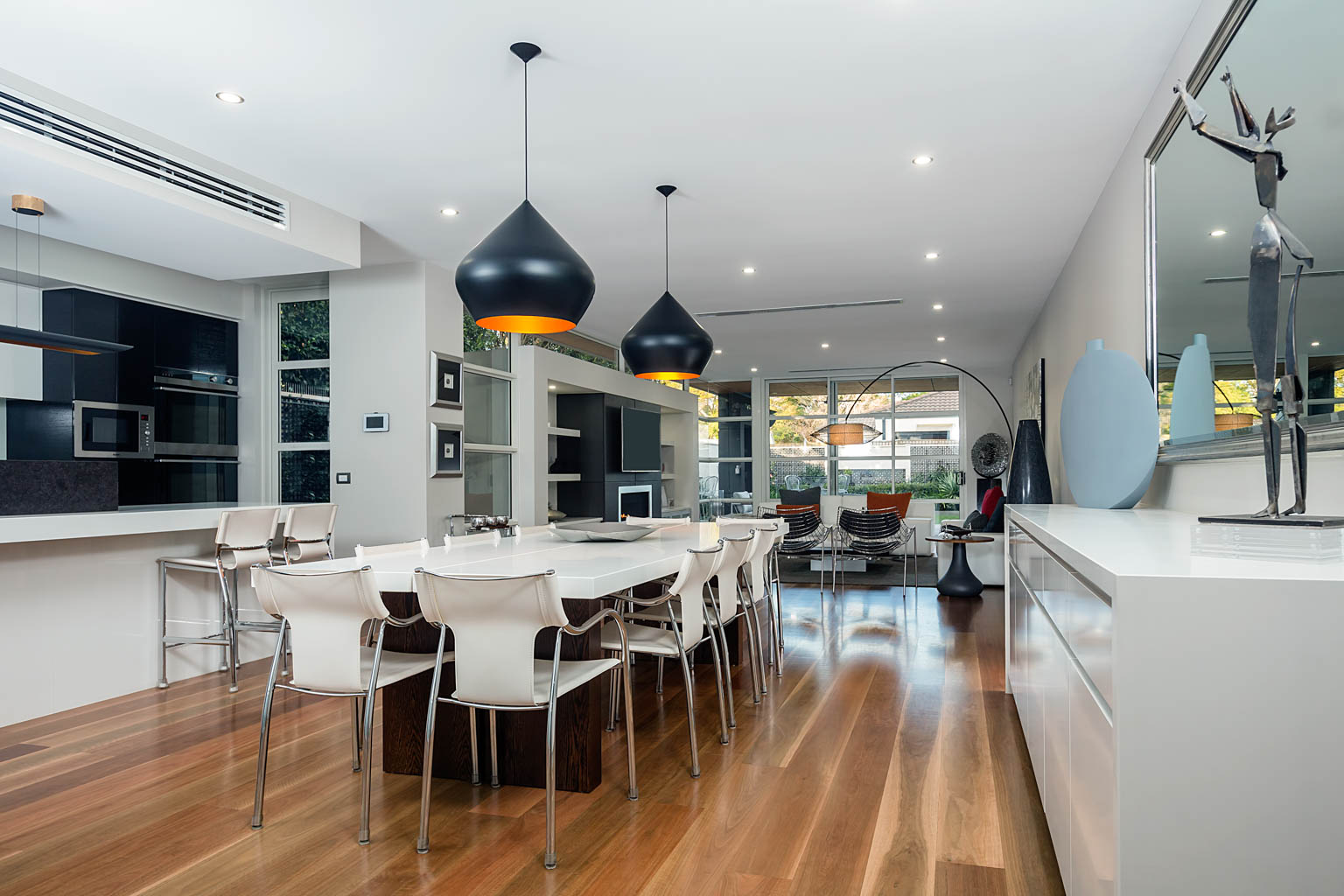 modern home interior photography of kitchen dining room and lounge