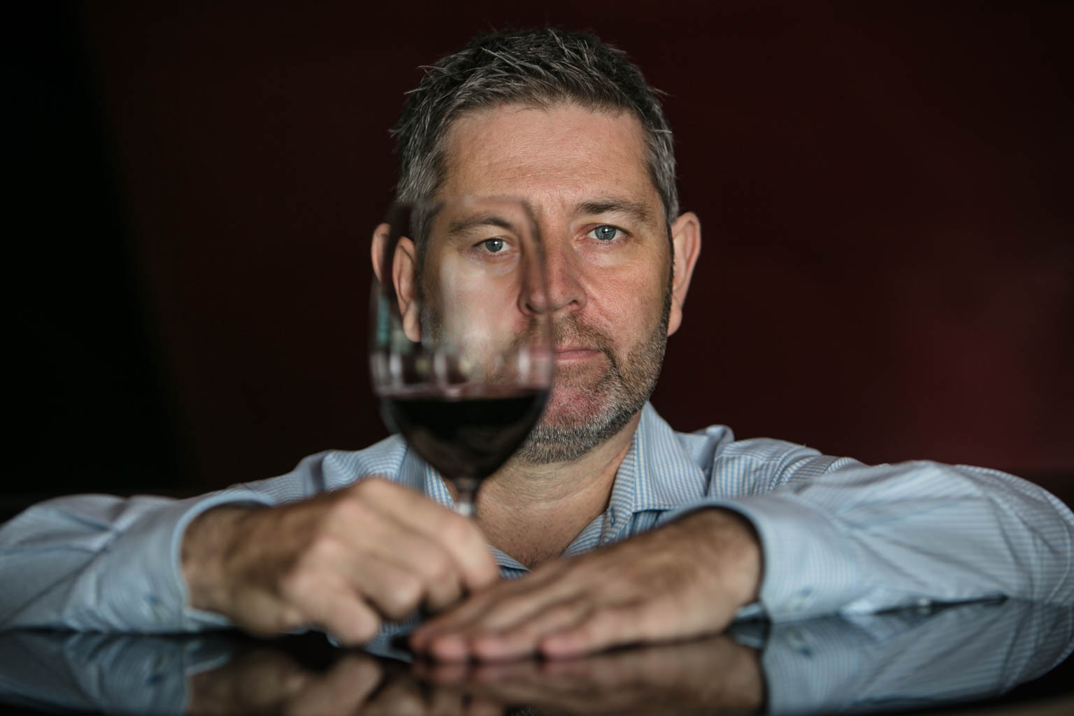 sommelier head shot with glass of wine