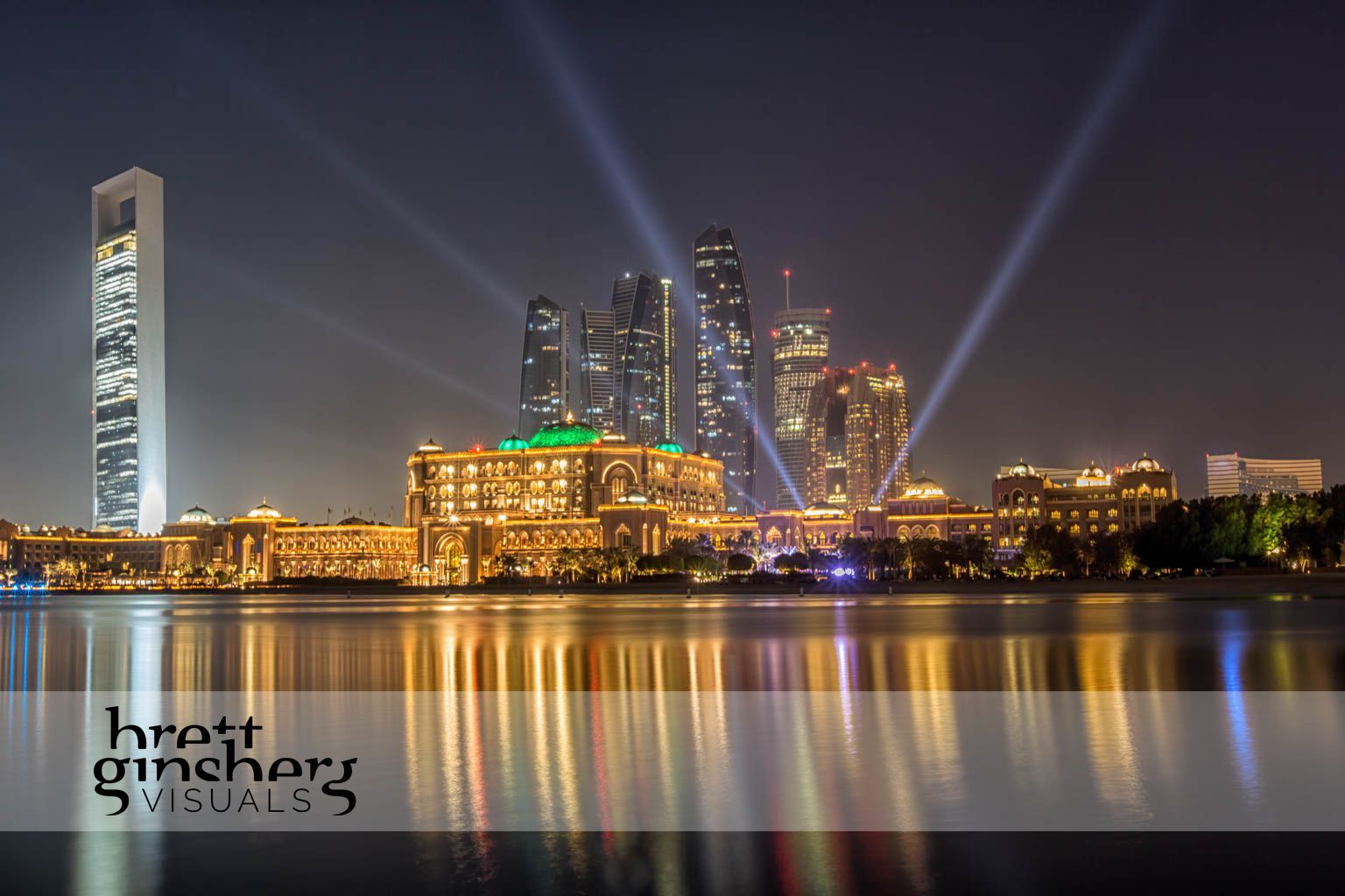 palace hotel in adu dhabi at night with search lights