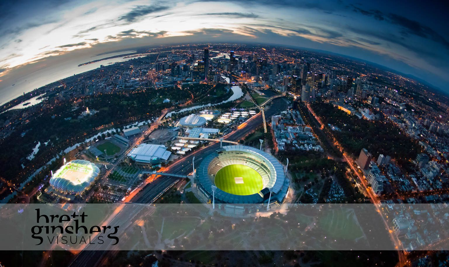 aerial image of melbourne at sunset with the melbourne cricket ground