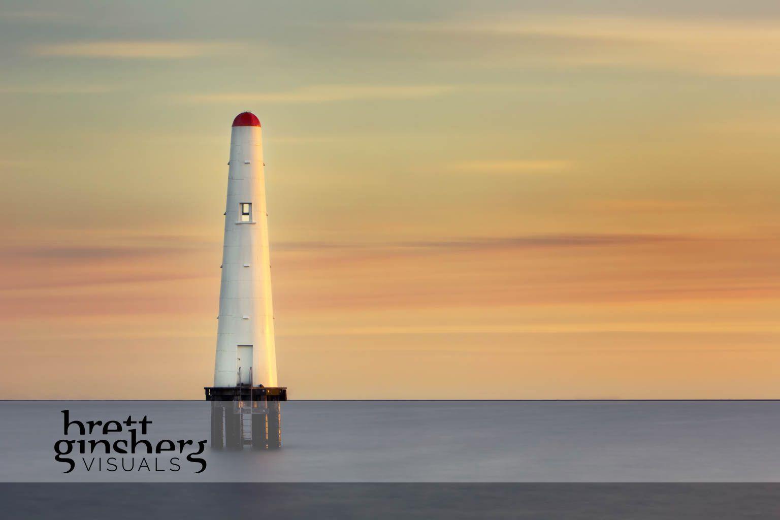 port melbourne beacon at sun set