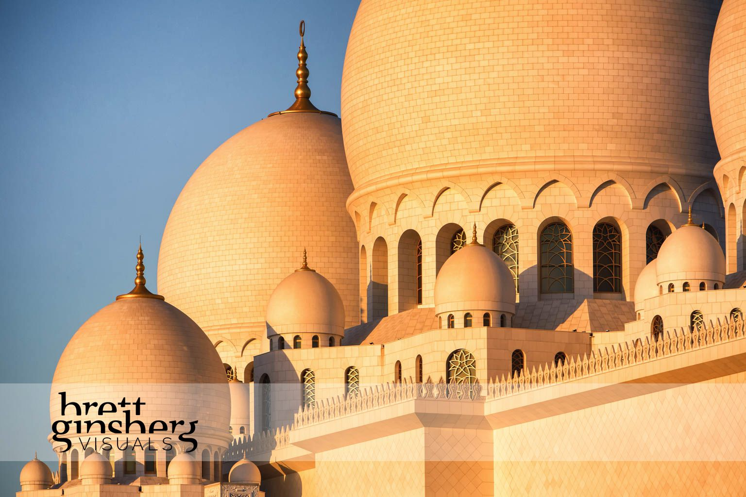 grand mosque at sun set in abu dhabi