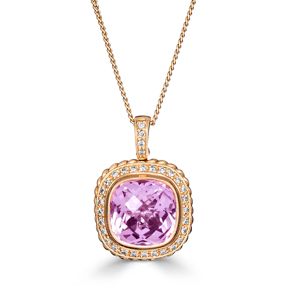 jewellery photography of pink stone pendant with rose gold setting and diamonds