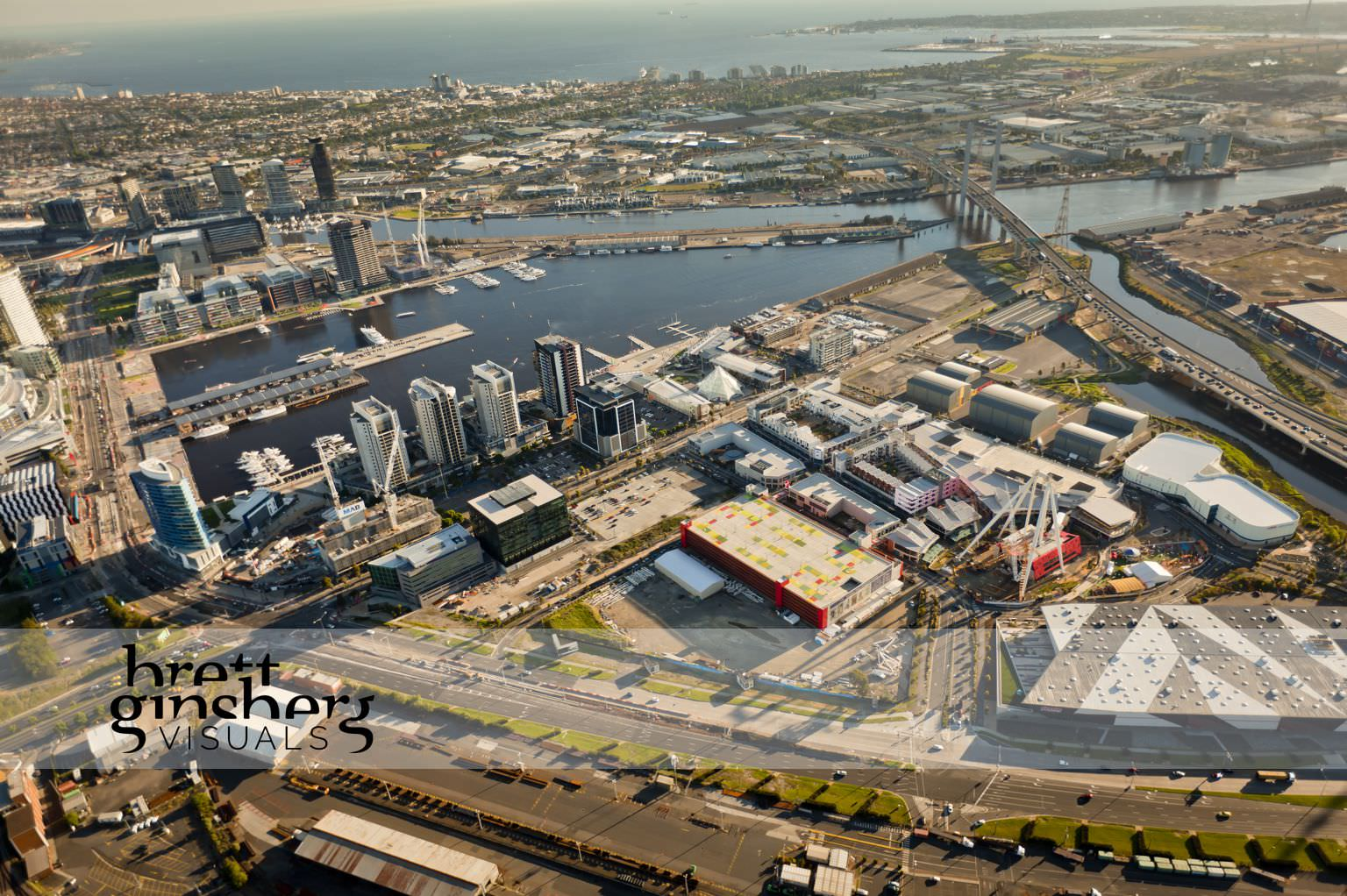 aerial drone photograph of the district docklands with wheel observation construction melbourne