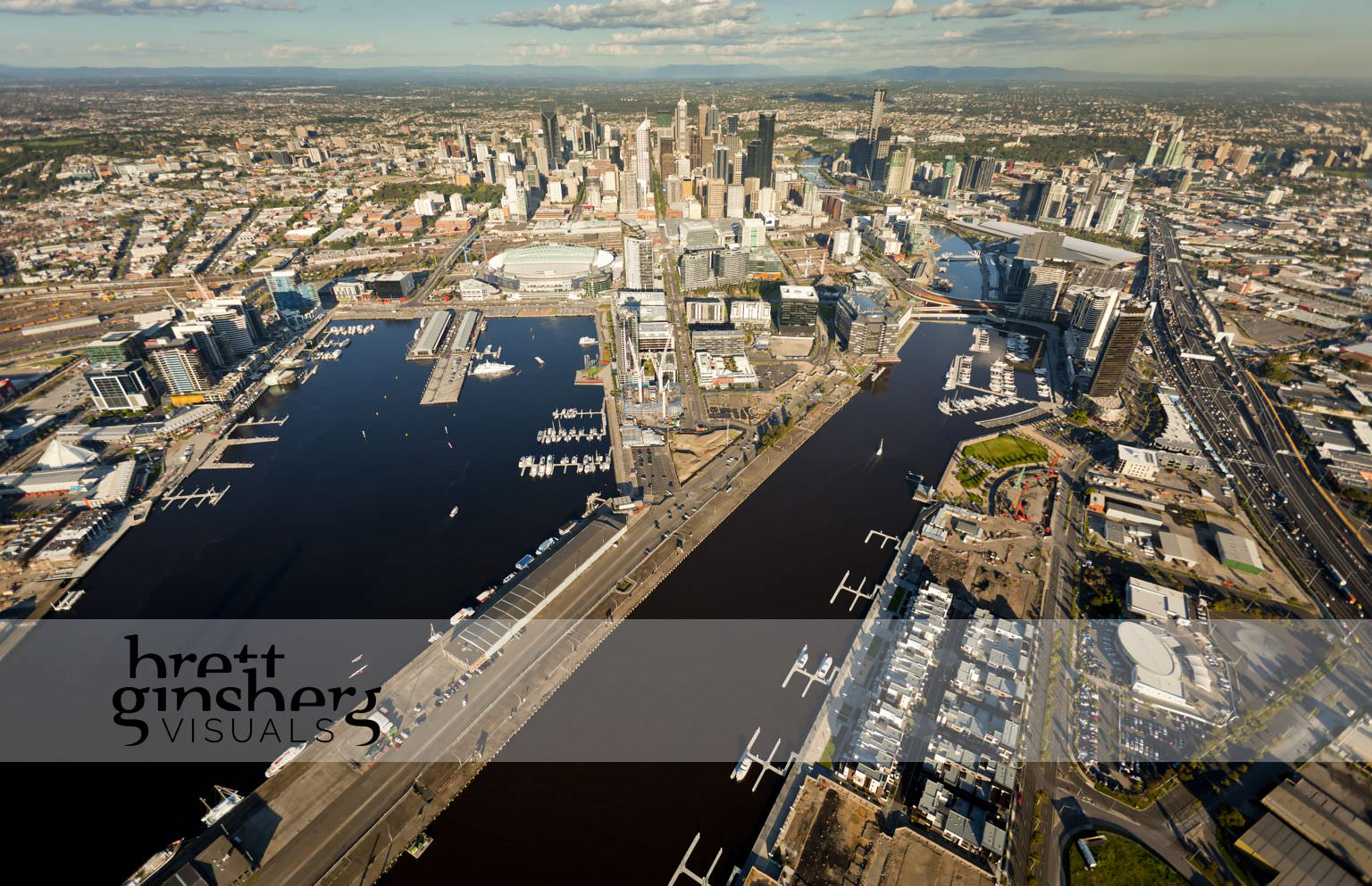 aerial drone photograph of docklands and city melbourne