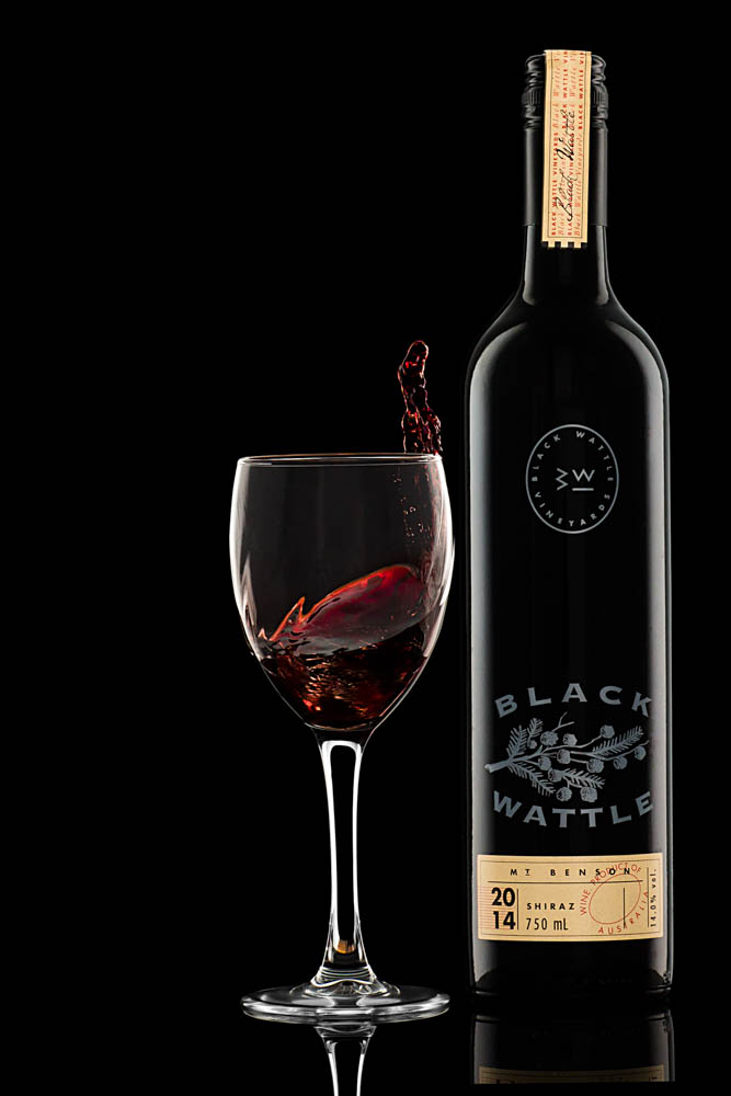 product photography of shiraz wine bottle and red wine glass
