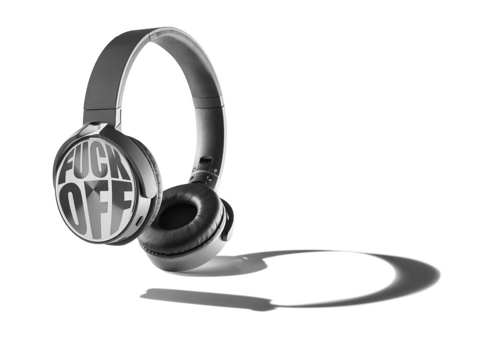 product photography of head phones with large shadow on white background