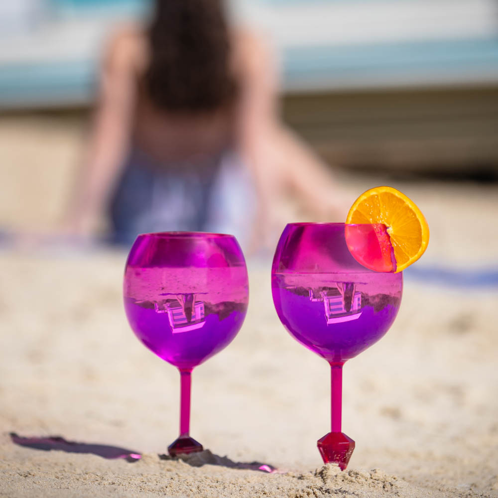 lifestyle example of Ecommerce Product Photography with 2 pink wine glasses in on beach Melbourne